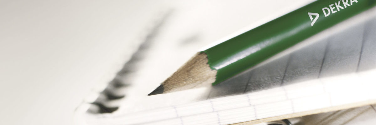 Pencil on Top of Note Pads --- Image by © Rick Barrentine/Corbis